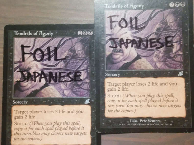 Tendrils of Agony with 'foil Japanese' written on them in marker